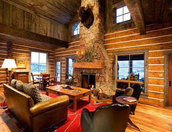 Stacked stone fireplace in cozy cabins to get lost in | LovelySpaces.com